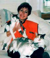Paula on couch w/ kitties